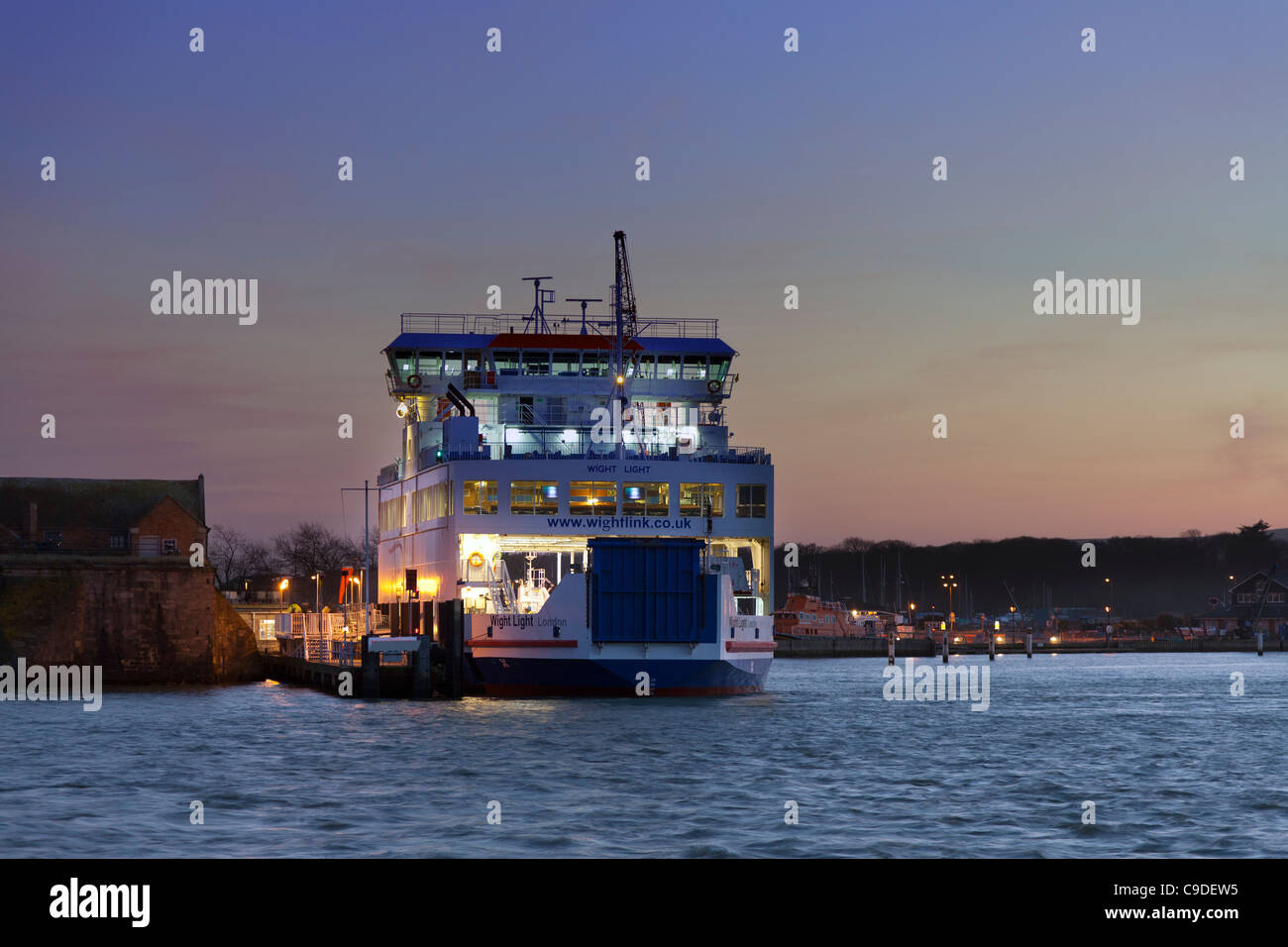 Solent Ferry Isle of Wight Yarmouth Lymington route at Dusk at entrance to harbour - Stock Image