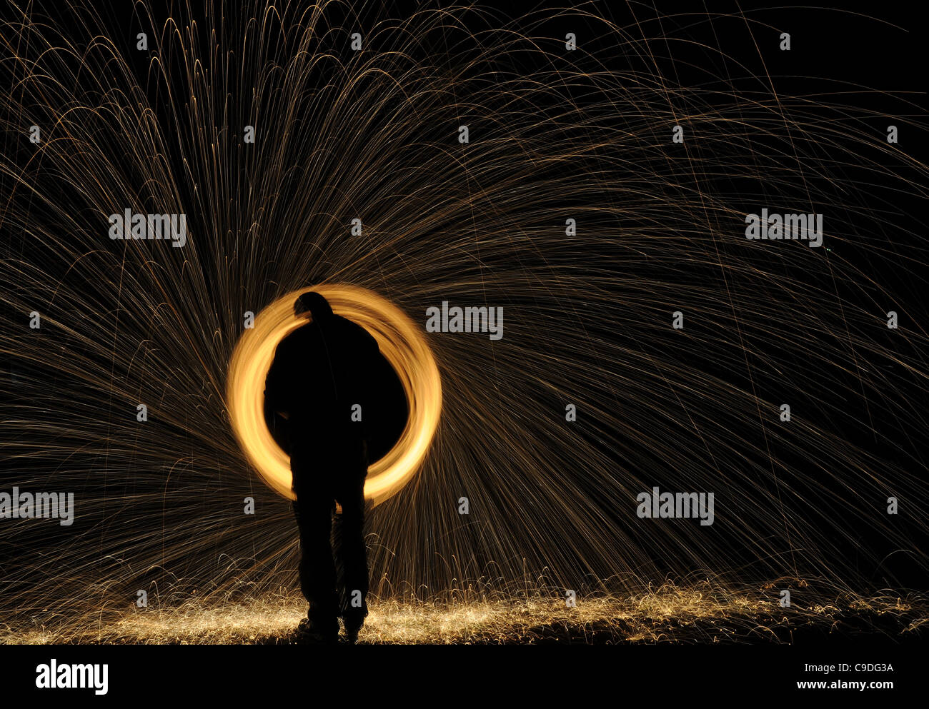 glowing spark spiral - Stock Image