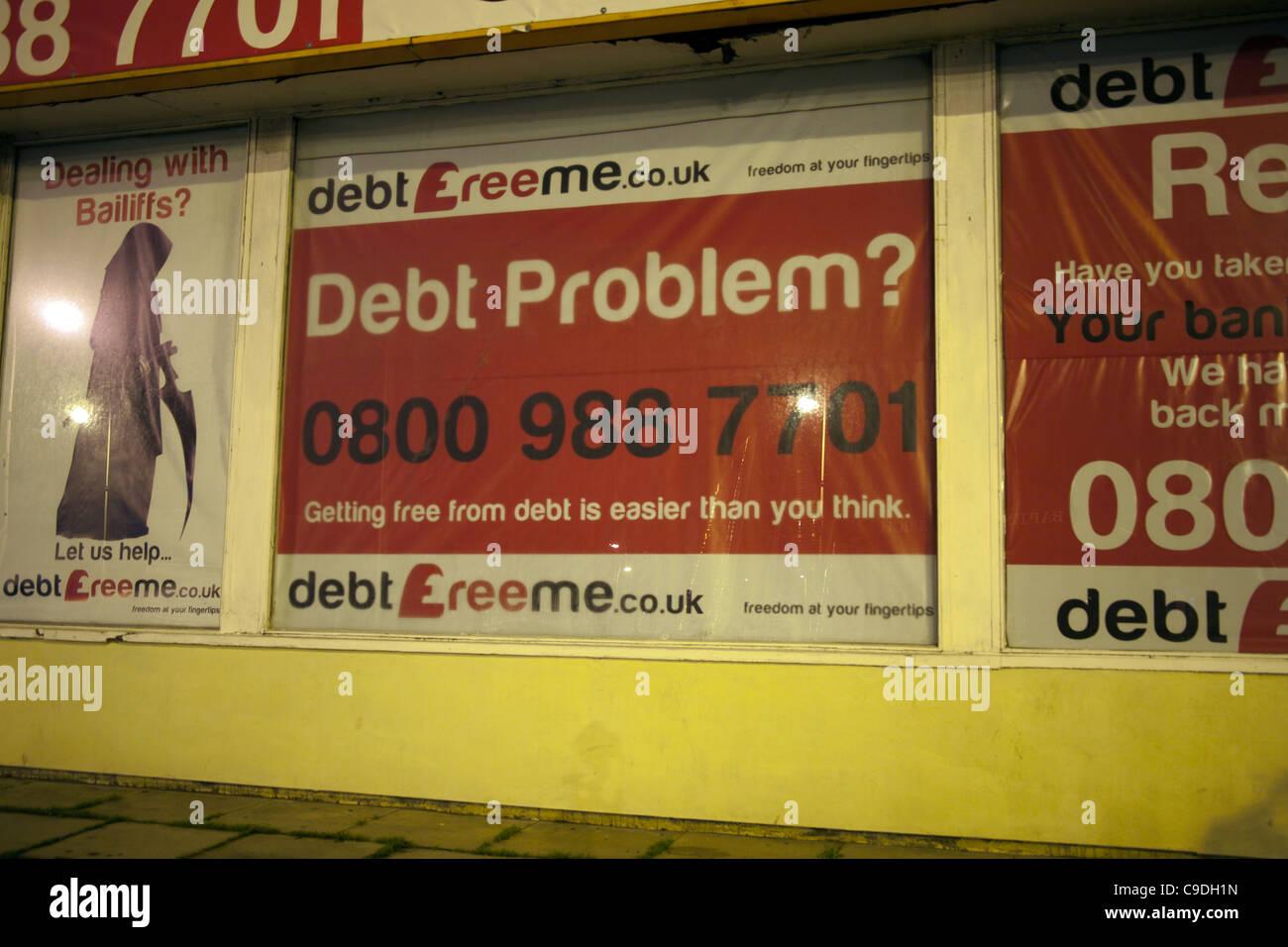Debt Problem Poster & Shop Front _Uk debt free shop front in Southport, Merseyside, UK - Stock Image