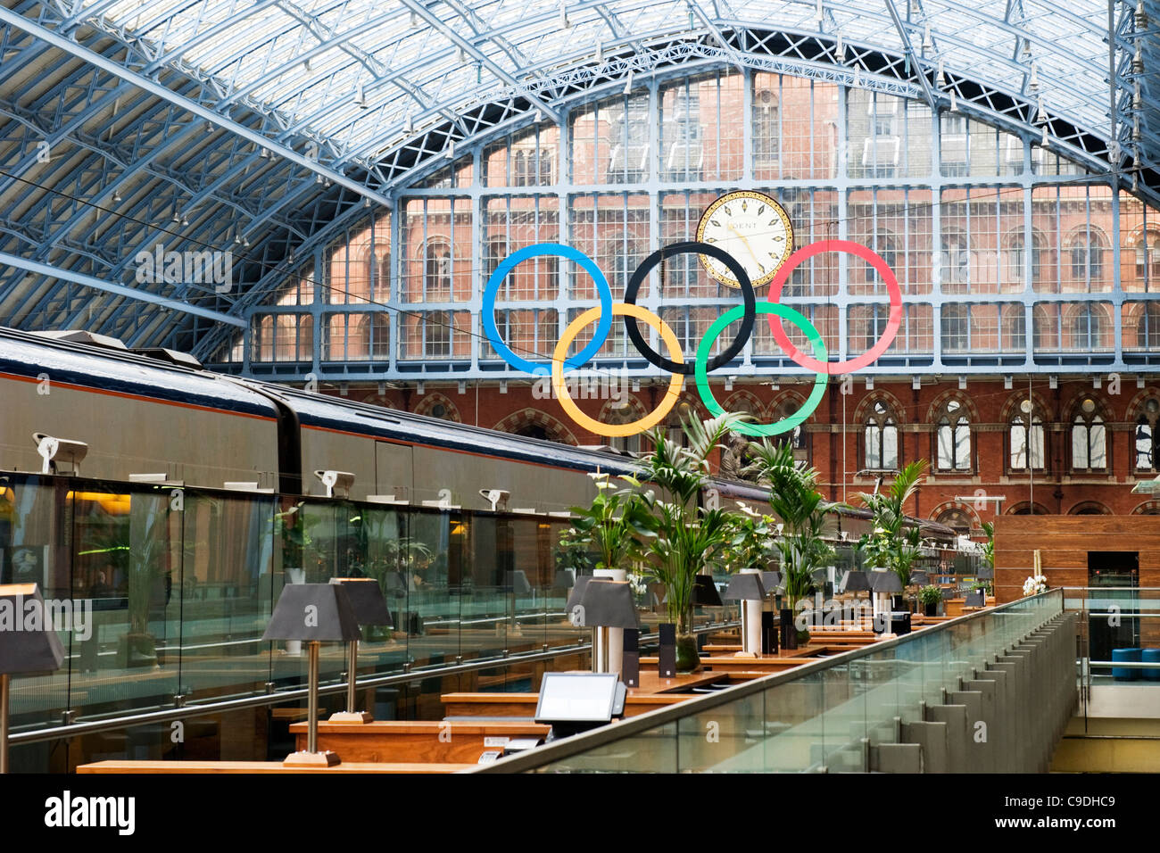 London St Pancras Station the Olympic rings from Champagne Bar Eurostar train in foreground glass roof roofs small - Stock Image