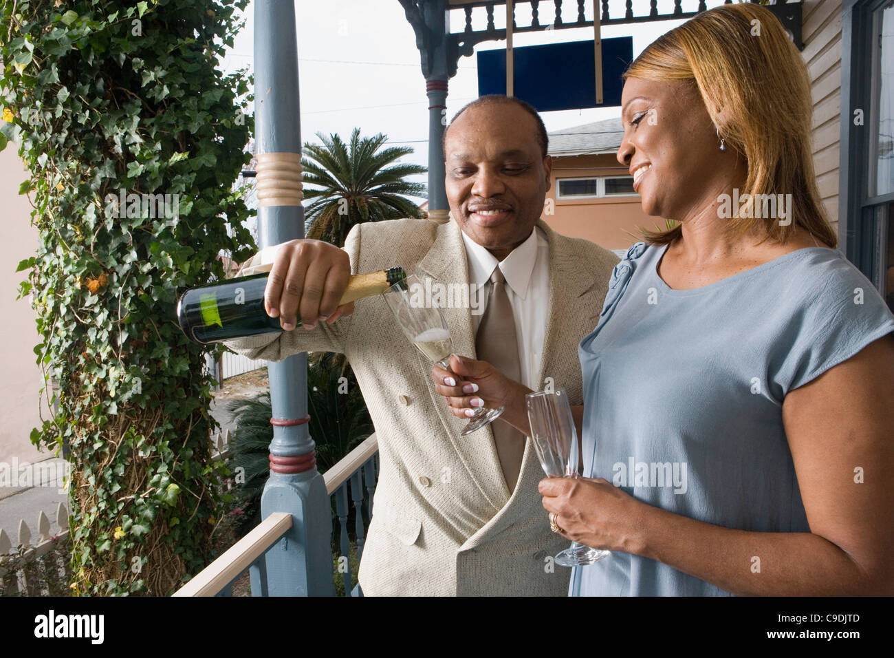 View of a mature couple celebrating with champagne - Stock Image