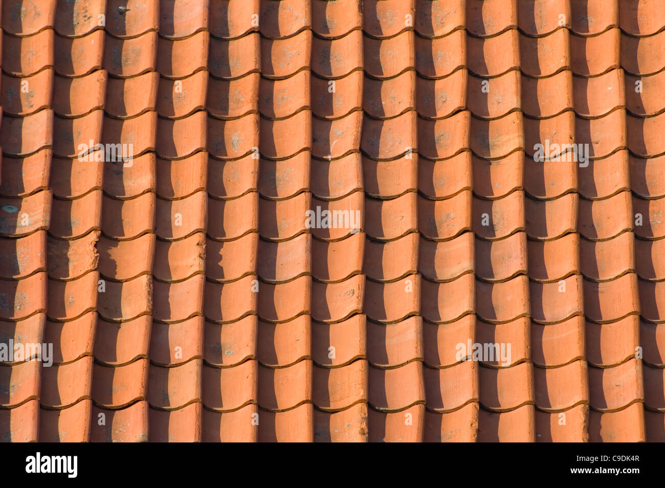 Old, red roof tiles - Stock Image