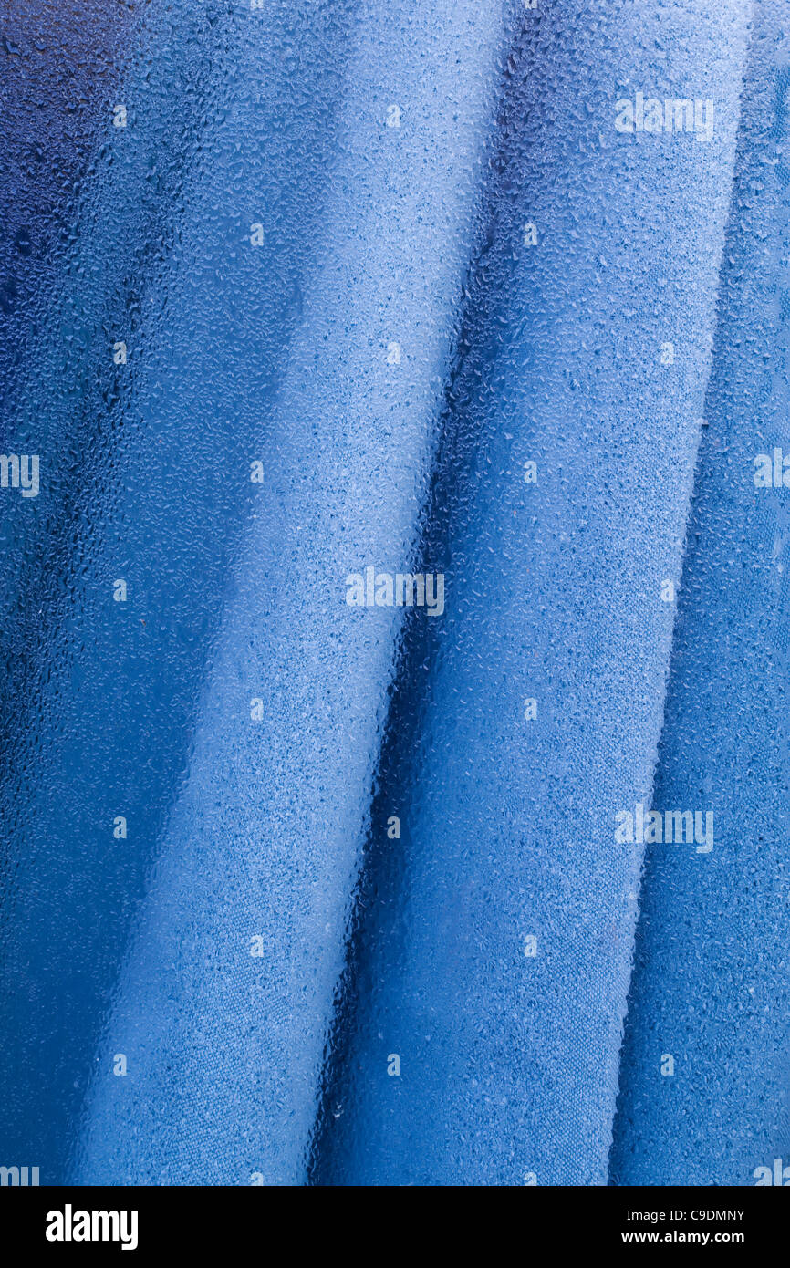 Condensation on an outside window glass. - Stock Image