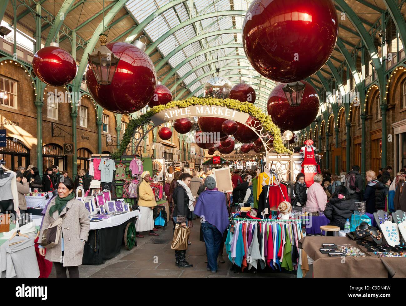 Christmas stalls at Apple Market in Covent Garden London UK - Stock Image