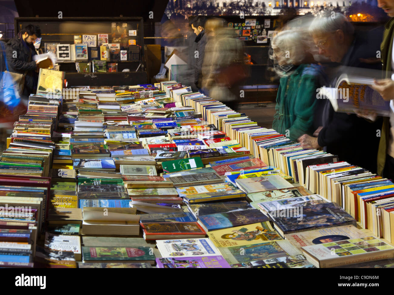 The open air secondhand book sales on the South Bank London before Christmas at dusk - Stock Image