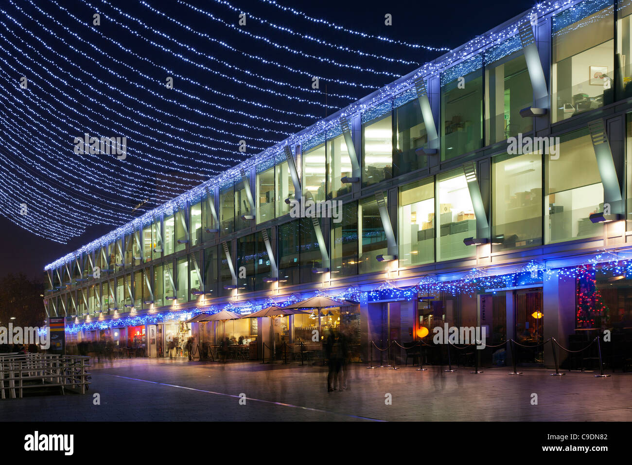 Christmas lights on the South Bank, London at night, looking through lines of Xmas lights - Stock Image