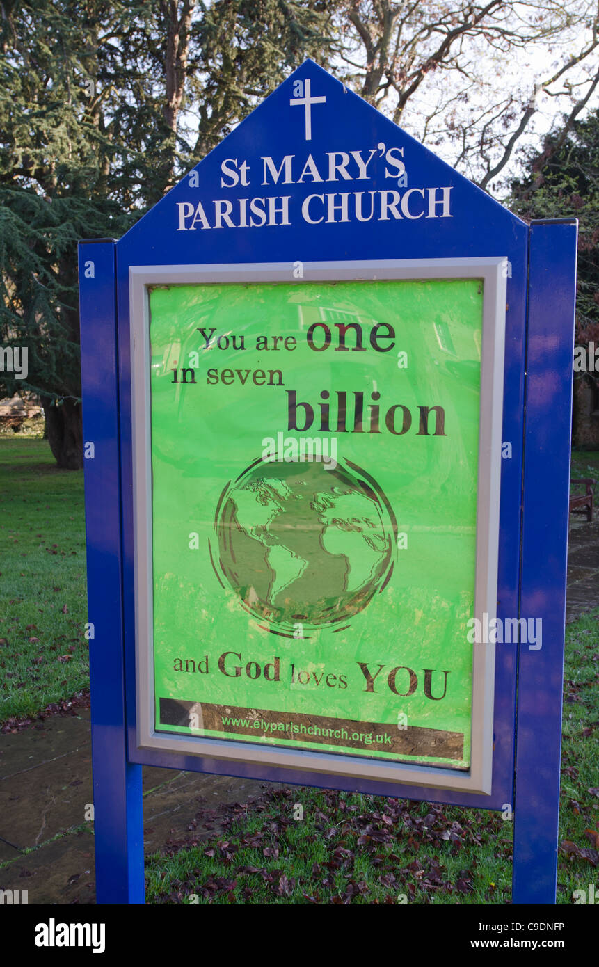 Seven Billion World population reached November 2011. St Mary's Church Ely Christian poster. - Stock Image