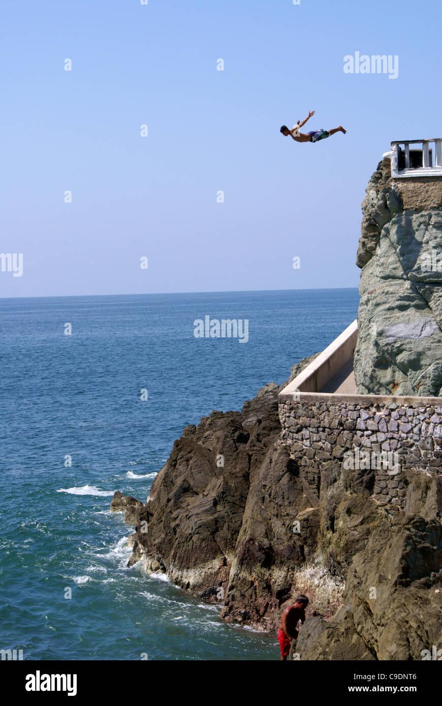 Cliff diver at Punta Clavadista in Mazatlan, Sinaloa, Mexico - Stock Image