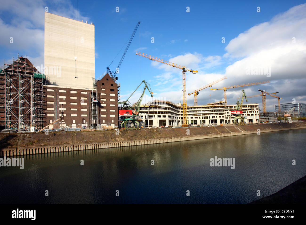 Construction site of a new administration building. Construction cranes. Innenhafen, Duisburg, Germany. Stock Photo