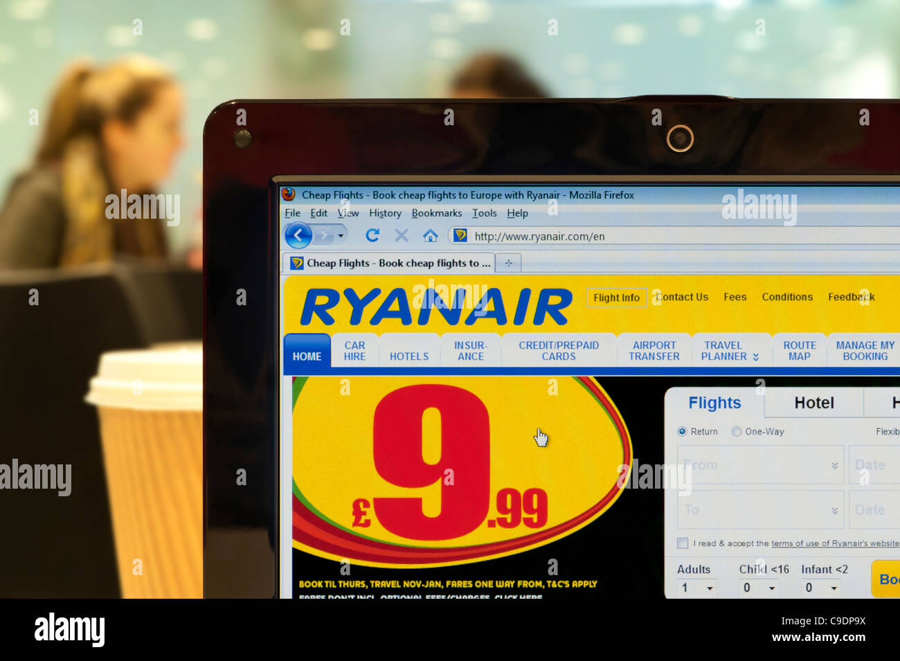 The Ryanair website shot in a coffee shop environment (Editorial use only: print, TV, e-book and editorial - Stock Image