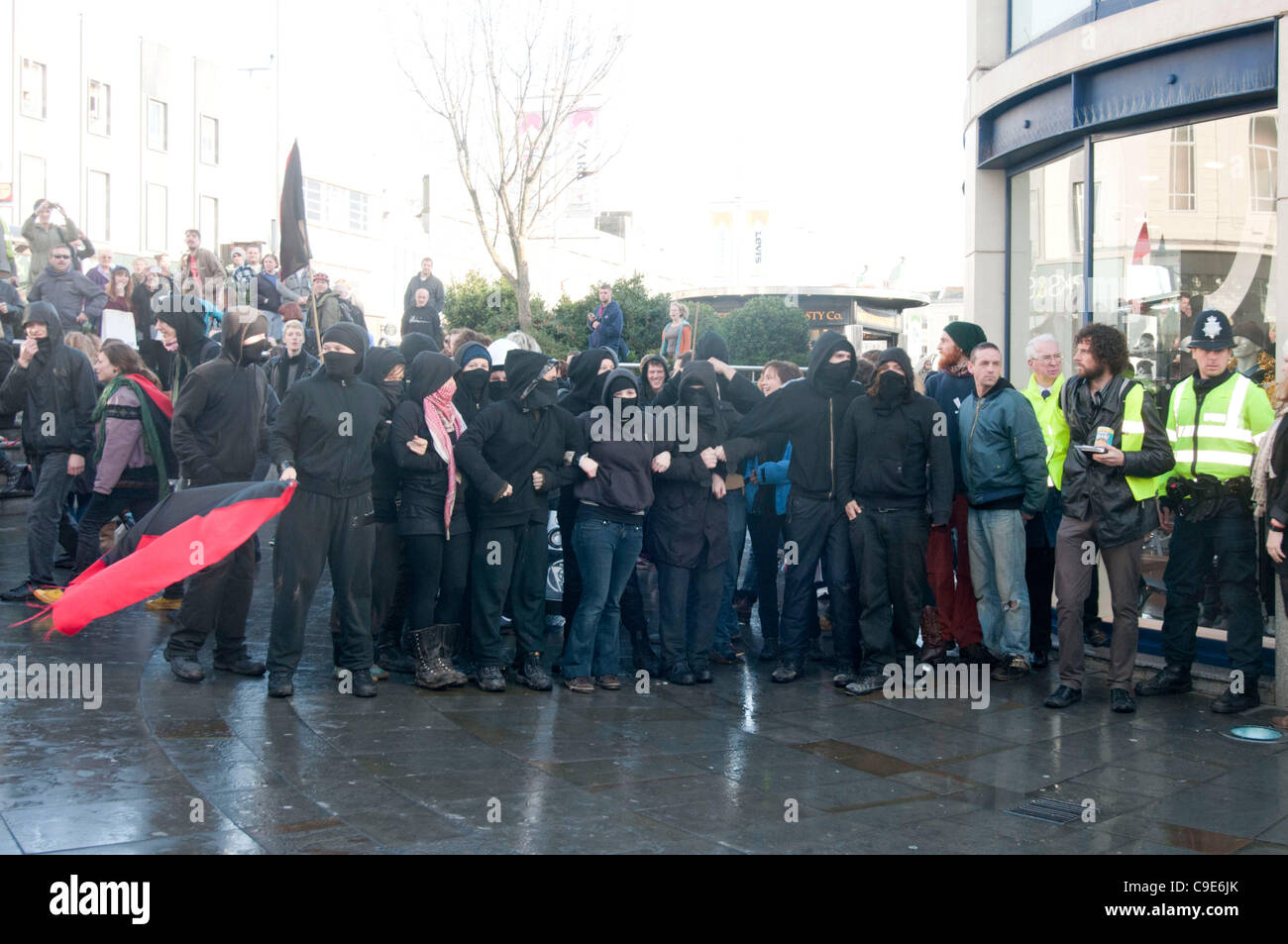 Brighton, UK. 30th Nov, 2011. Anarchists veer off from the agreed route during the public sector strike march in - Stock Image