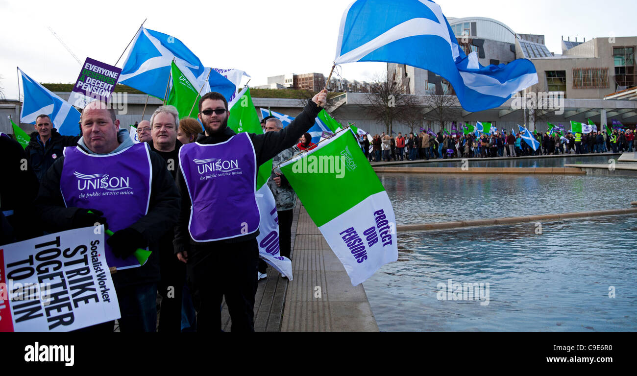 Edinburgh, UK. 30th Nov, 2011. Public sector workers and union members march past the Scottish Parliament in Edinburgh - Stock Image