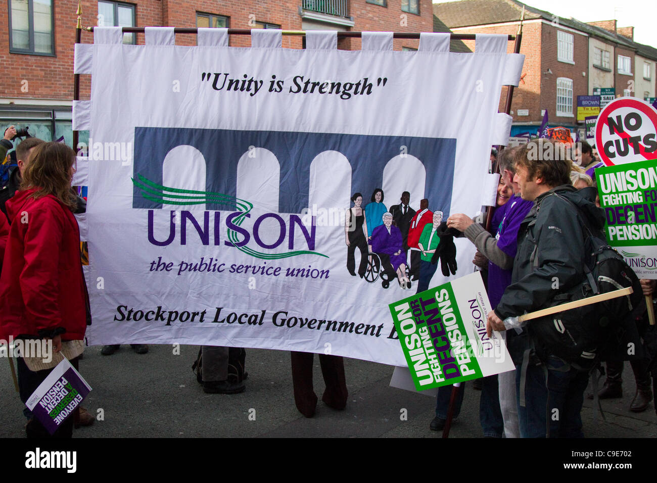 """""""No Cuts"""" banners at the Unison march Manchester, UK. 30th Nov, 2011. Striking public sector workers march in Manchester Stock Photo"""