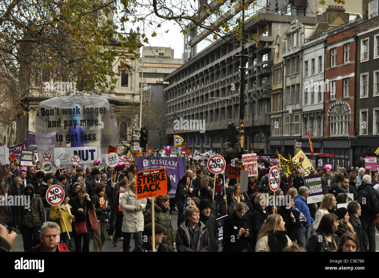 London, UK, 30/11/2011 Strikers march through central London carrying an inflatable mascot in protest against public - Stock Image