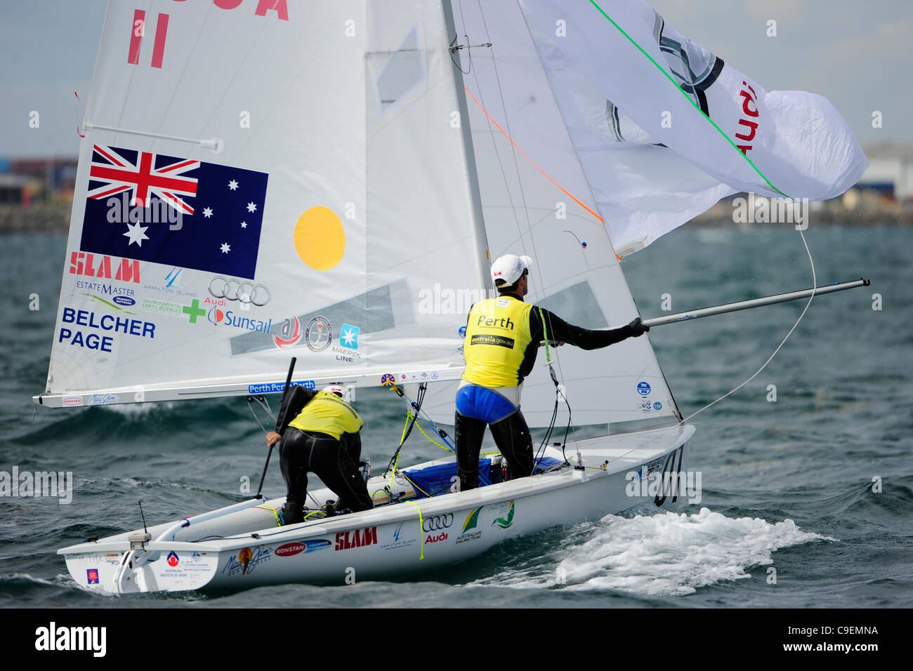 09.12.2011. Perth, Australia. Mathew Belcher (AUS) and Malcolm Page (AUS) adjust their headsail in the 470 men's - Stock Image
