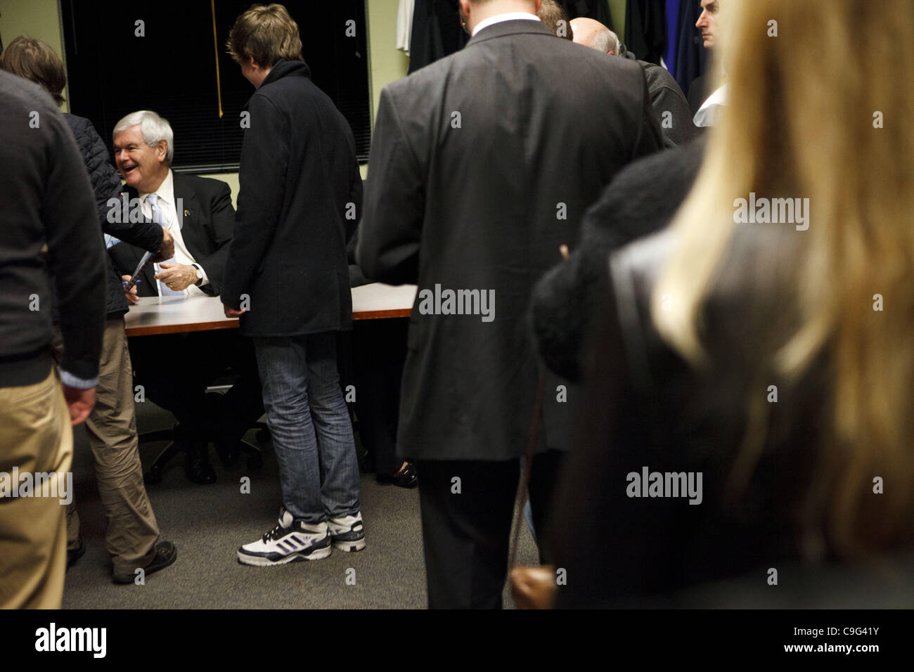 Dec. 19, 2011 - Hiawatha, Iowa, U.S. - Republican presidential candidate NEWT GINGRICH socializes as he signs an - Stock Image