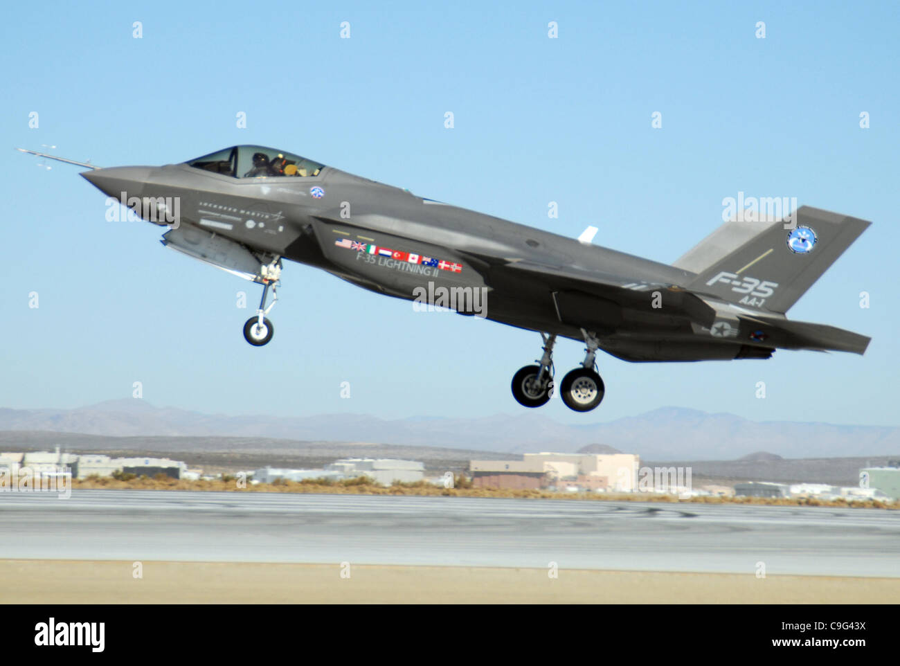 An F-35 Joint Strike Fighter, marked AA-1, lands Oct. 23 at Edwards Air Force Base, Calif. The F-35 Integrated Test - Stock Image