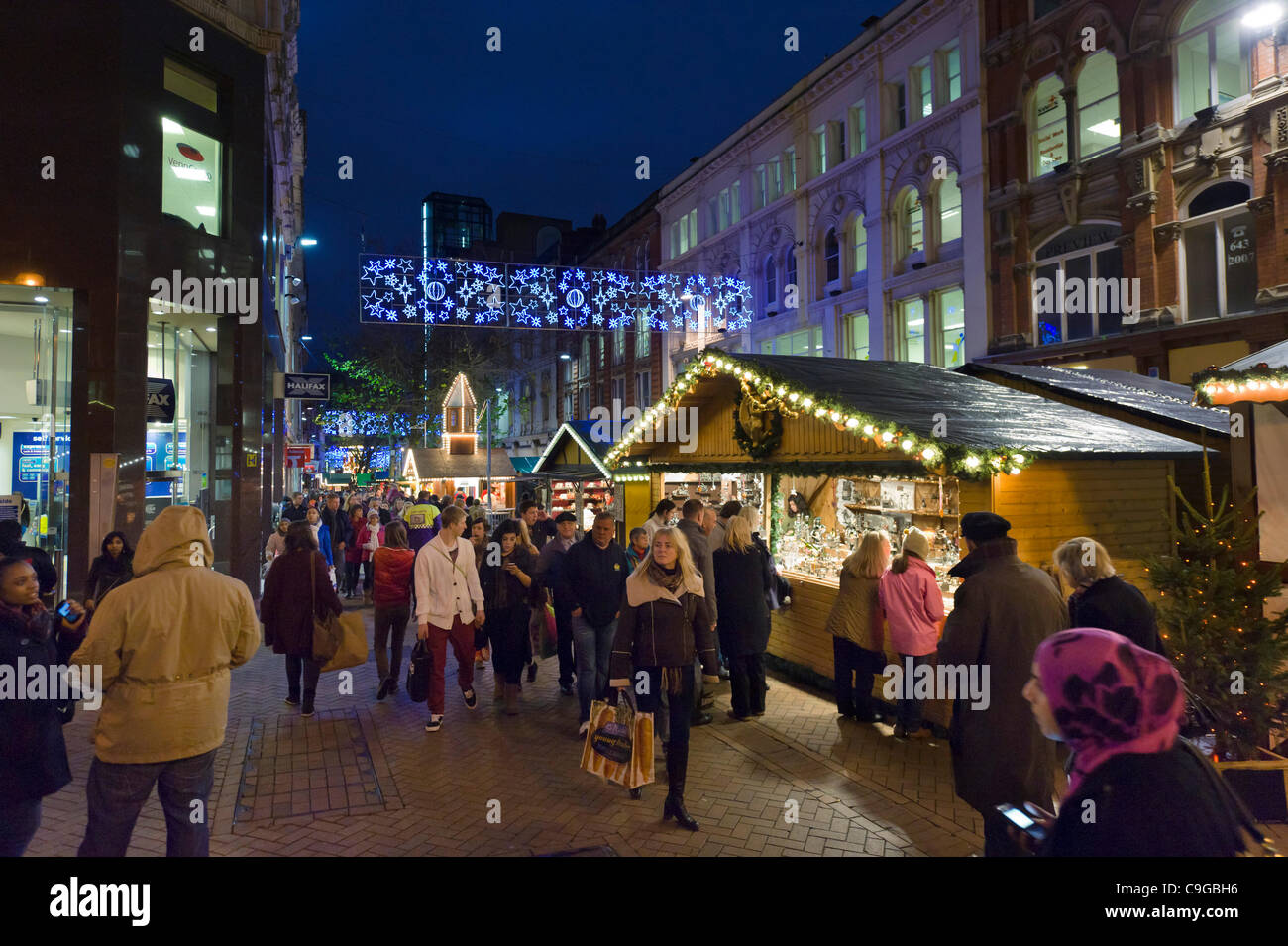 Nighttime crowds of last minute Christmas shoppers at the Frankfurt German Christmas Market on New Street, Birmingham, - Stock Image
