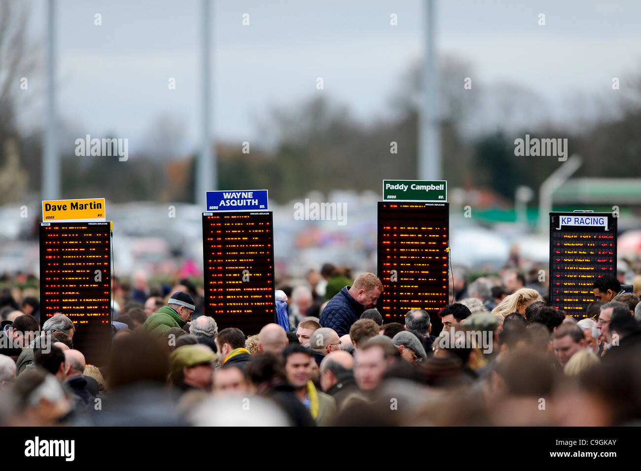 26.12.2011 Sunbury, England. Punters mill during The William Hill Winter Festival on Boxing Day at Kempton Park - Stock Image