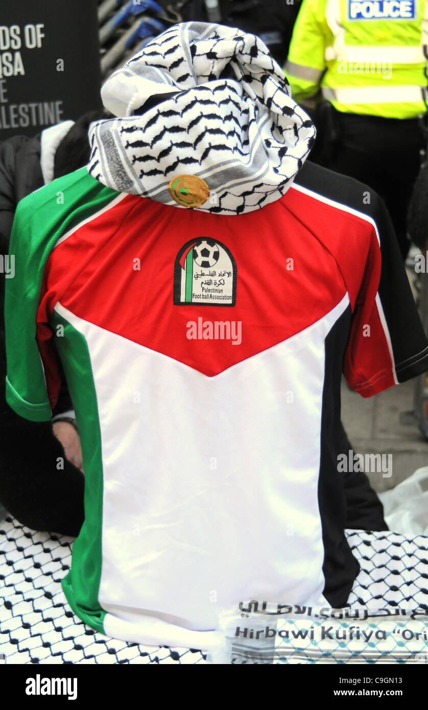 Palestinian football strip is put on display during the Stop the War Coalition's demonstration outside the Israeli - Stock Image