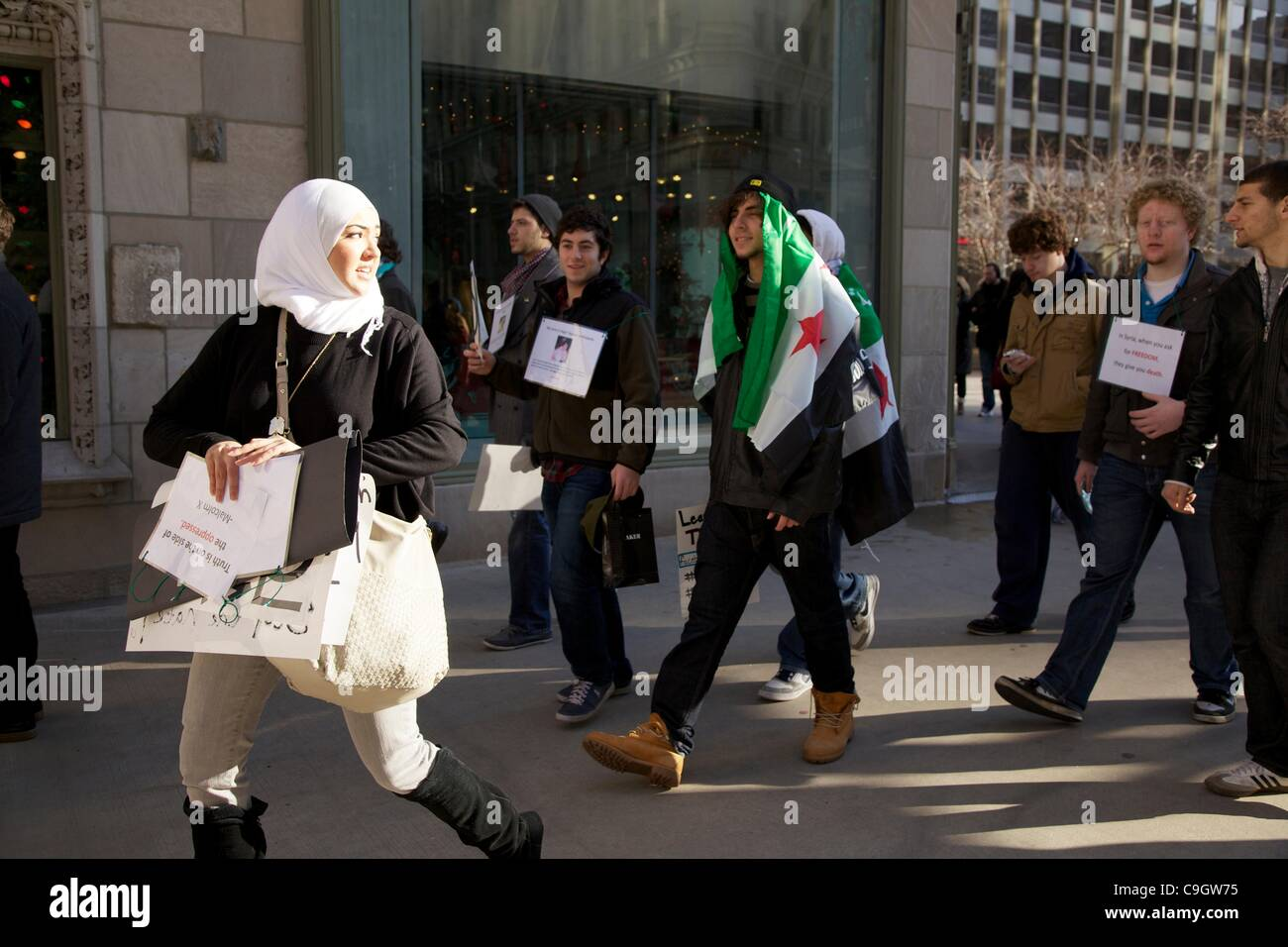 Chicago, USA, 29/12/2011. Protesters march past Tribune Tower during anti-Syrian government protest. The demonstrators Stock Photo