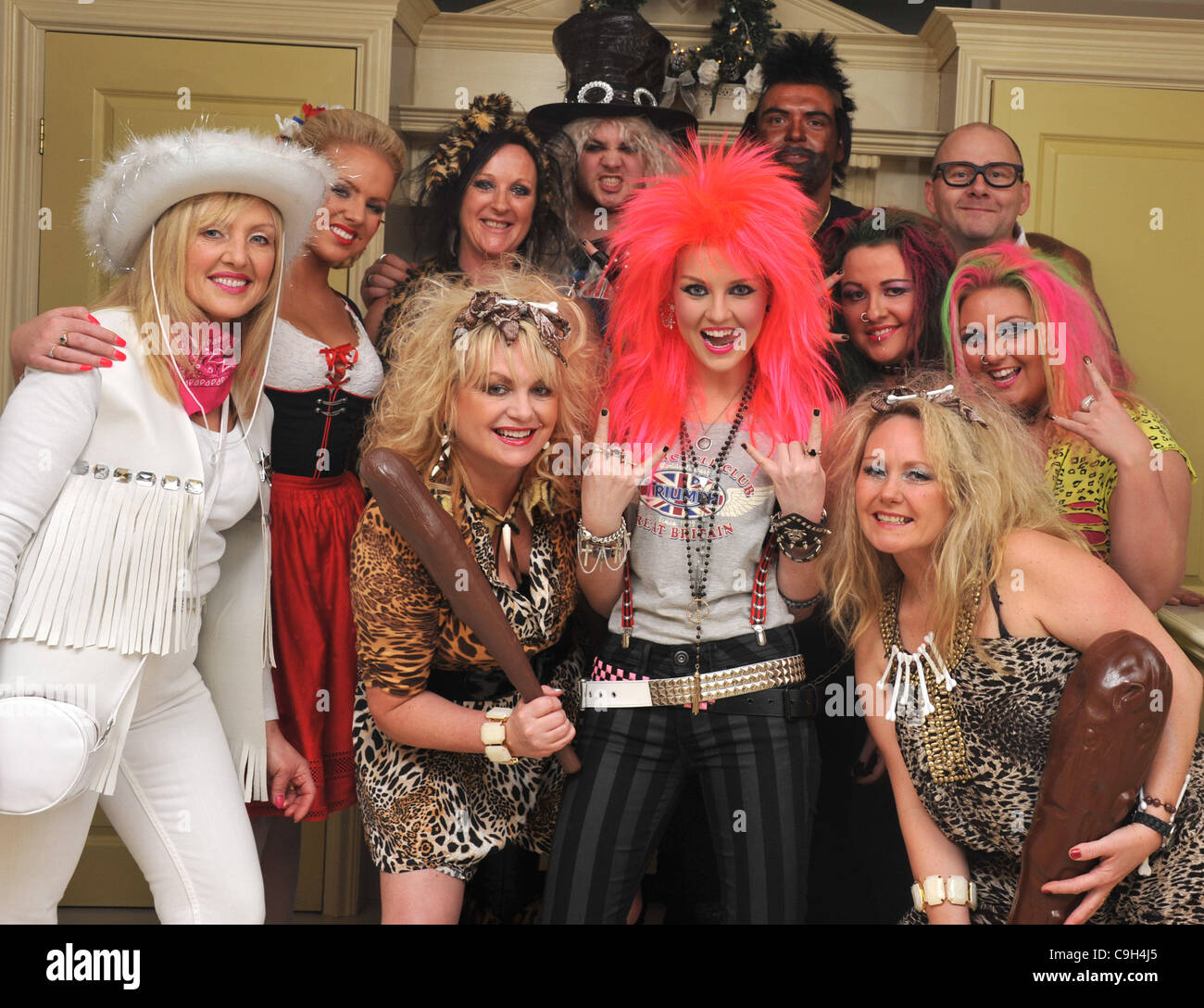 UK, X-Factor winning band member Perrie Edwards of Little Mix as a red haired Rock Chick, her fancy dress outfit - Stock Image