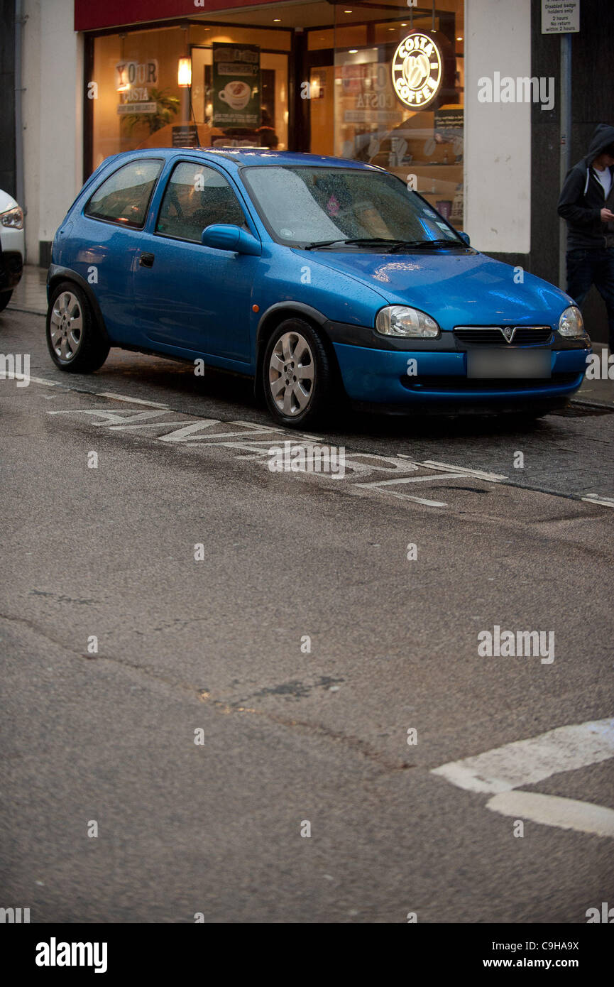 January 4 2012. Car parked illegally in a disabled bay on the streets of Aberystwyth Wales UK, . The town has been - Stock Image