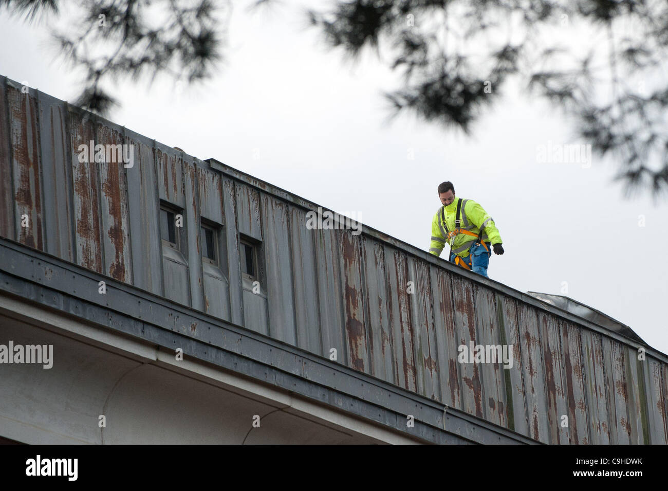 Jan 5 2012. High winds tear off metal roofing sheets 'the size of two tennis courts'  from the roof of the - Stock Image