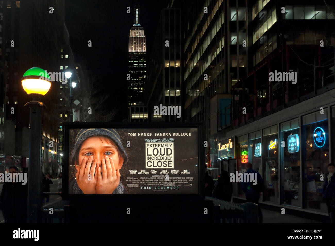 Manhattan, New York, USA - January 9, 2012: Movie poster 'Extremely Loud & Incredibly Close' hangs lit - Stock Image