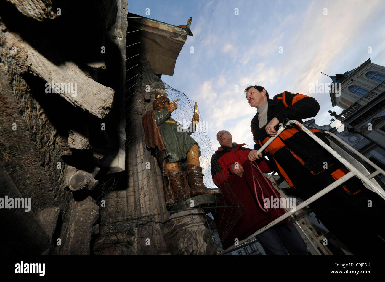 Prague, Czech Republic. 13th Jan, 2012. Restorers remove sculptures from Prague's Astronomical clock in the - Stock Image