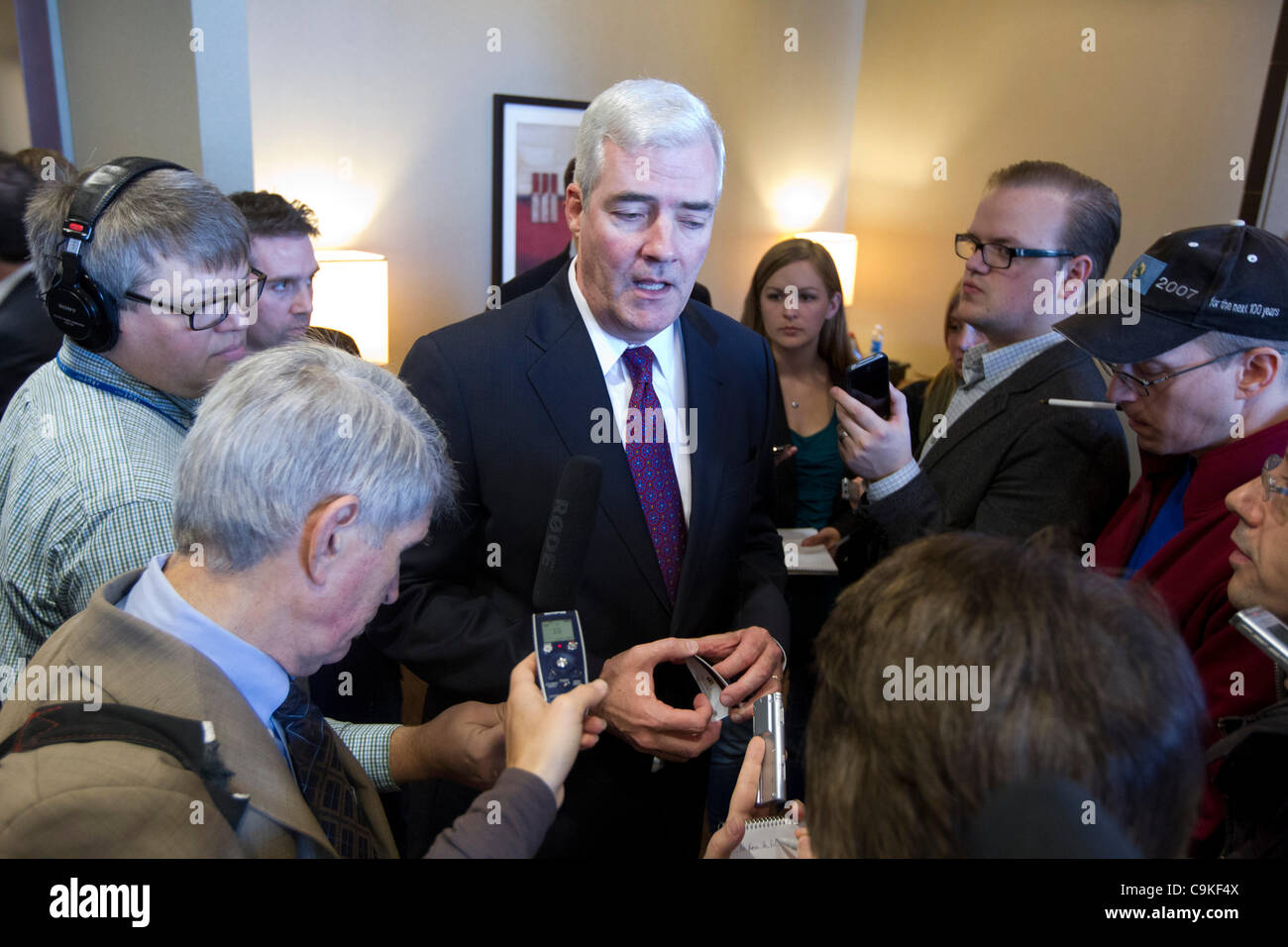 Reporters surround Ray Sullivan, communications director for Republican presidential nominee candidate Rick Perry. - Stock Image