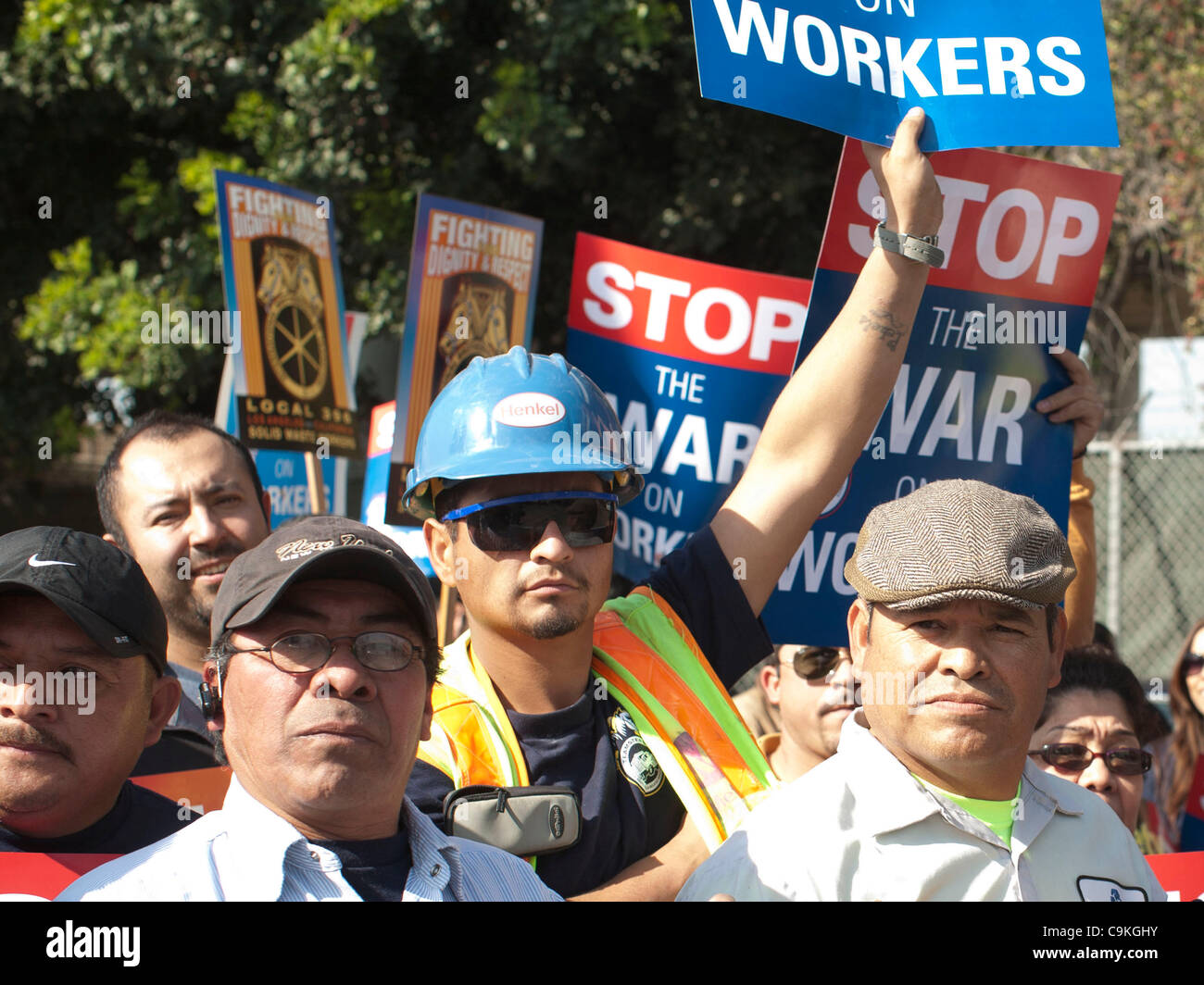 Members of the Teamsters holds a sign in support of workers