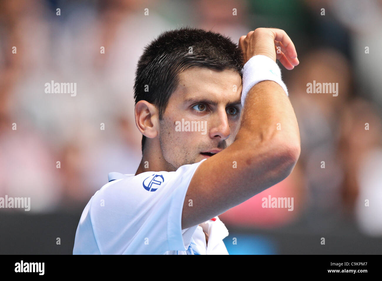 Novak Djokovic playing Nicolas Mahut at the Australian Open, Melbourne, January 21, 2012. - Stock Image