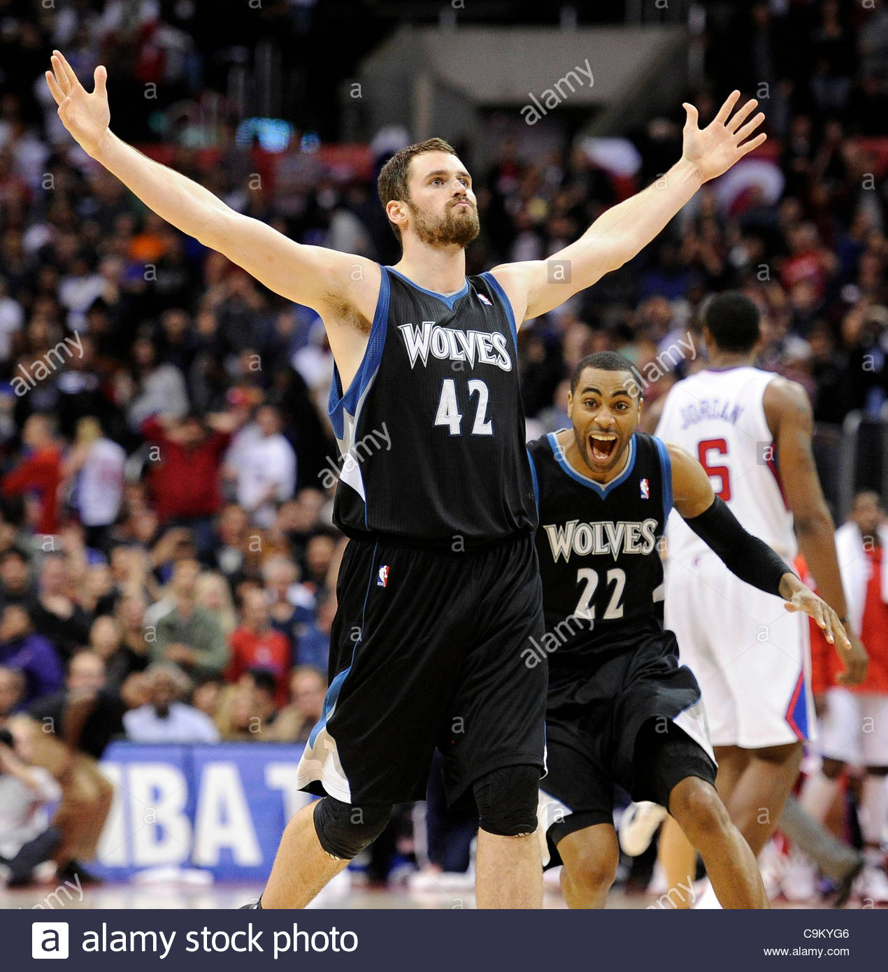 The Timberwolves Kevin Love 42 Raises His Arms In The Air After