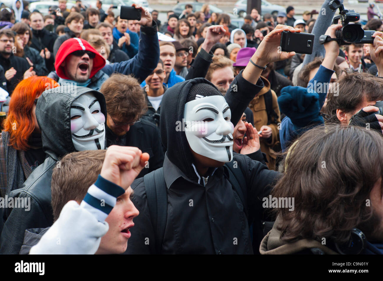 Anonymous Crowd Protest Against Internet Anti-Piracy Law, ACTA (Anti-Counterfeiting Trade Agreement), a bill that - Stock Image