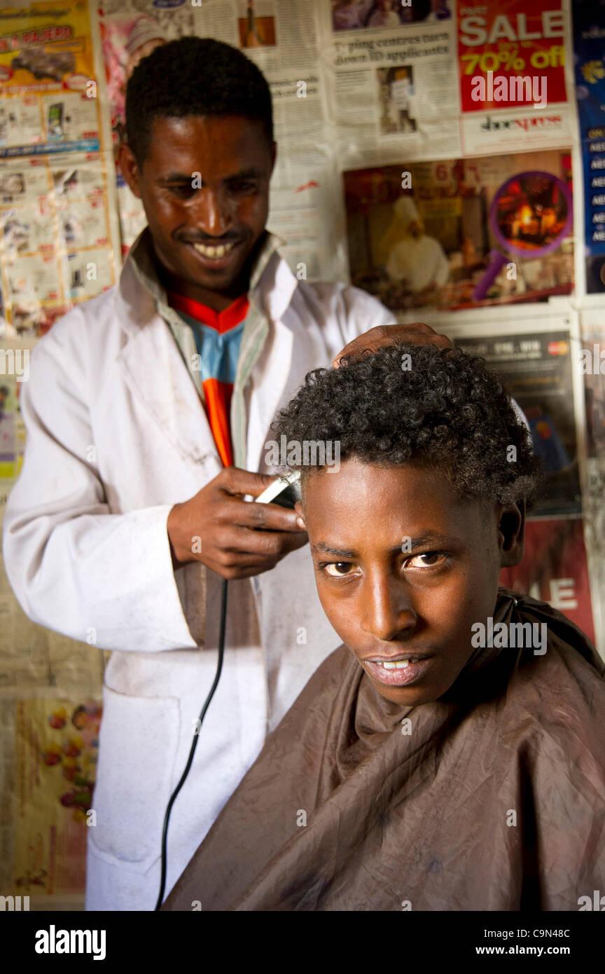 Jan. 19, 2012 - Farta (Woreda, South Gondar (Zone, Ethiopia - January 19, 2012, Checheho, Ethiopia - A barber works - Stock Image