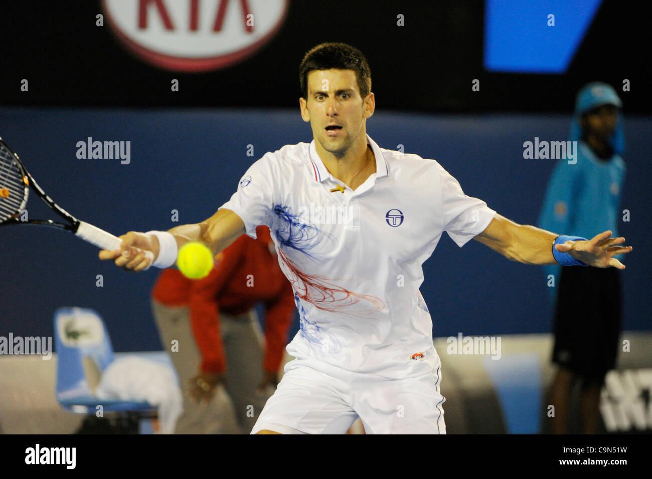 29.01.2012 Australian Open Tennis Mens Final from Melbourne Park. Novak Djokovic (SRB) returns a shot in his match - Stock Image