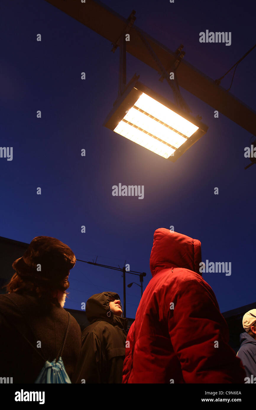 Visitors to Super Bowl Village in downtown Indianpolis took advantage of the warming stations on the first day of Stock Photo