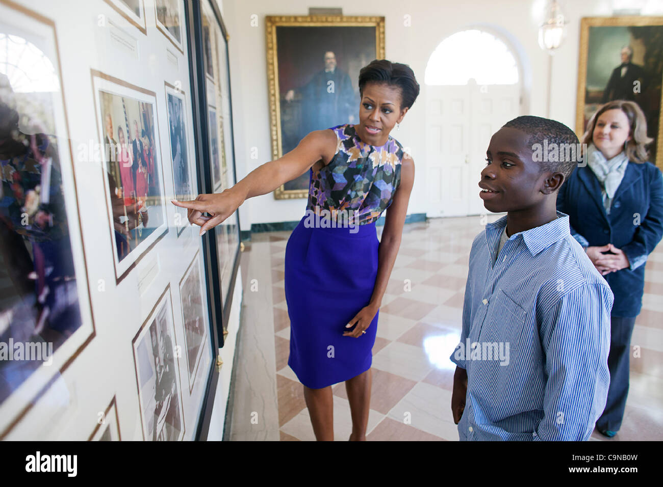 First Lady Michelle Obama shows NFL Super Kid James Gale, 11, historical photos from previous administrations on - Stock Image