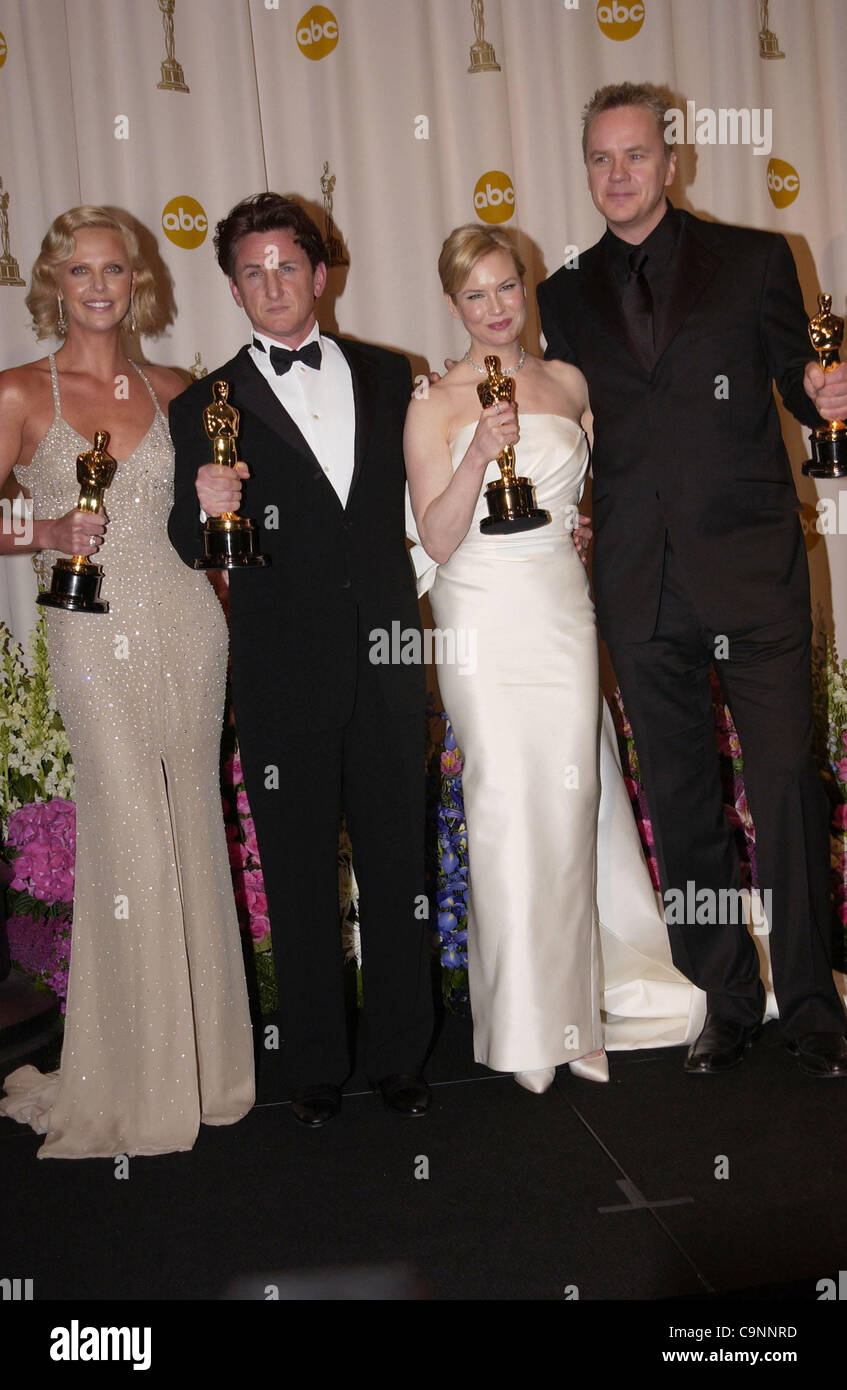 Feb 29, 2004; Hollywood, CA, USA; OSCARS 2004: Actress CHARLIZE THERON winner for best actress in 'Monster' SEAN PENN winner for best actor in 'Mystic River' with RENEE ZELLWEGER winner for best supporting actress in 'Cold Mountain' and TIM ROBBINS in the press room at the 76th Annual Academy Awards Stock Photo