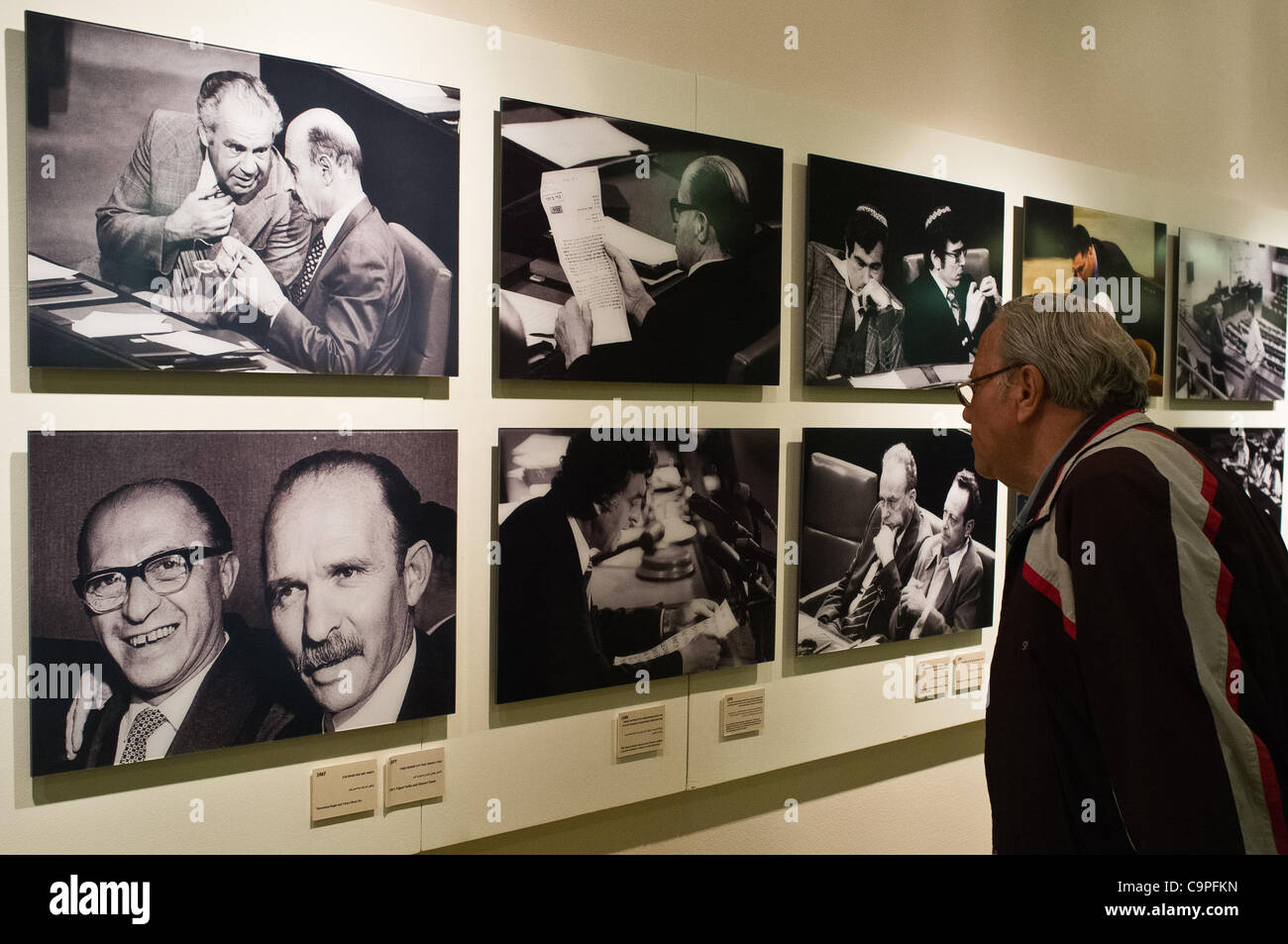 A visitor in the Knesset views a collection of historical photos on display as thousands of Israelis visit the Knesset - Stock Image