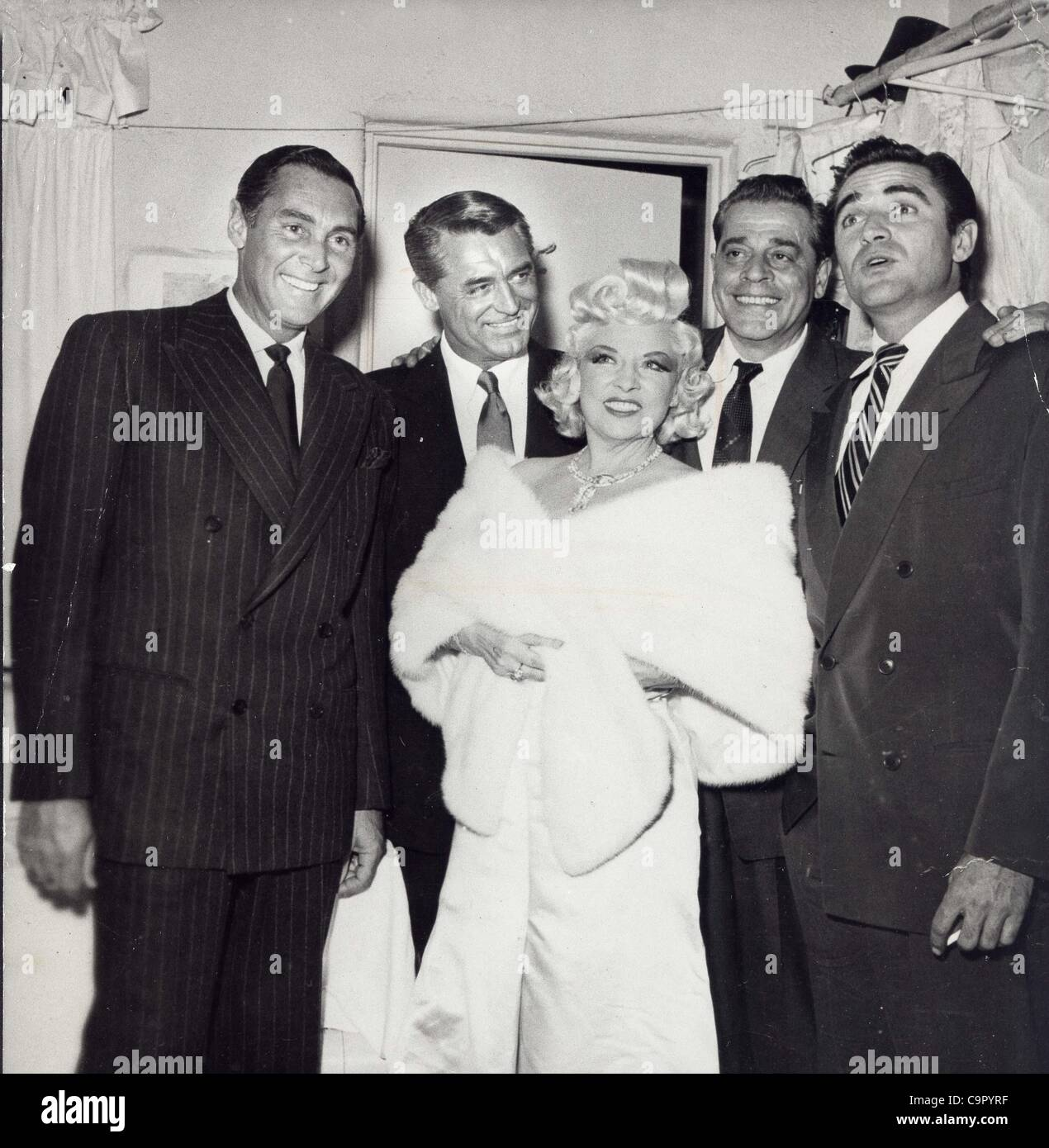 CARY GRANT with Phil Rees Jack LaRue , Steve Cochran and Mae West.1950's.Supplied by   Photos, inc.(Credit Image: - Stock Image