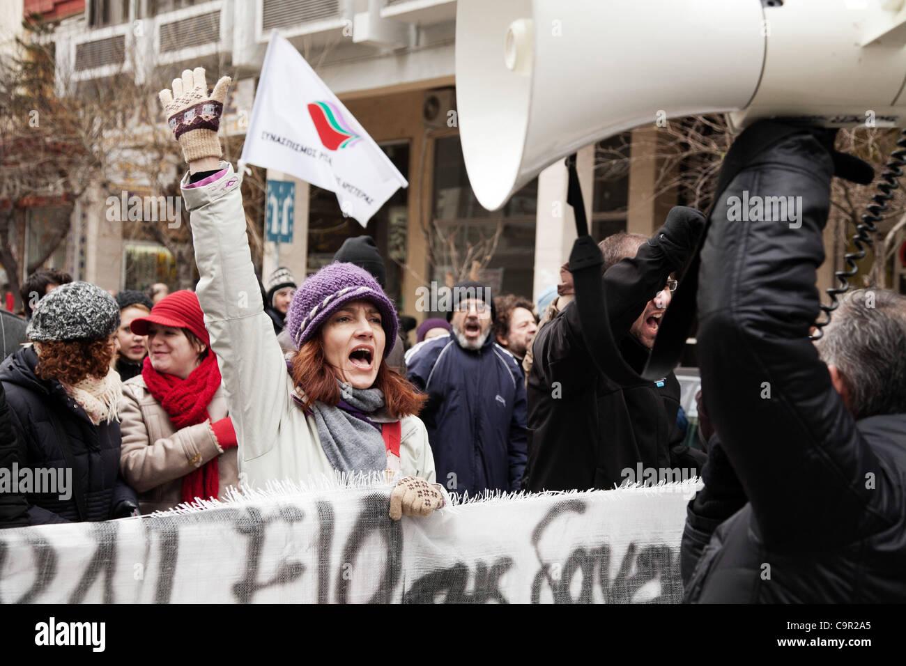 Greek protester shouting slogans against the new stringent economic measures. 48-hour nationwide strike. Protests - Stock Image