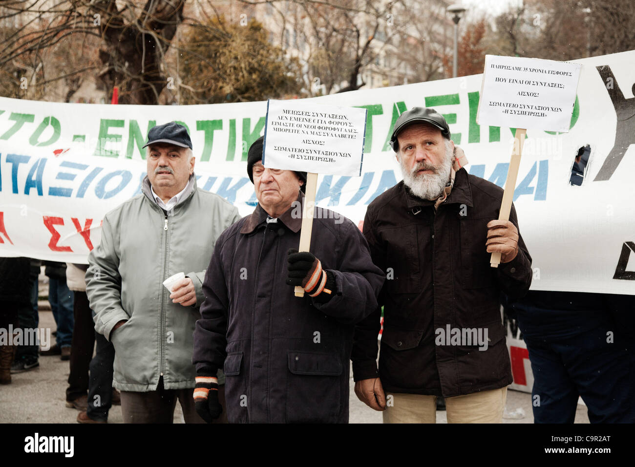 Greek elderly protesters carry a placards against the new austerity measures. 48-hour nationwide strike. Protests - Stock Image
