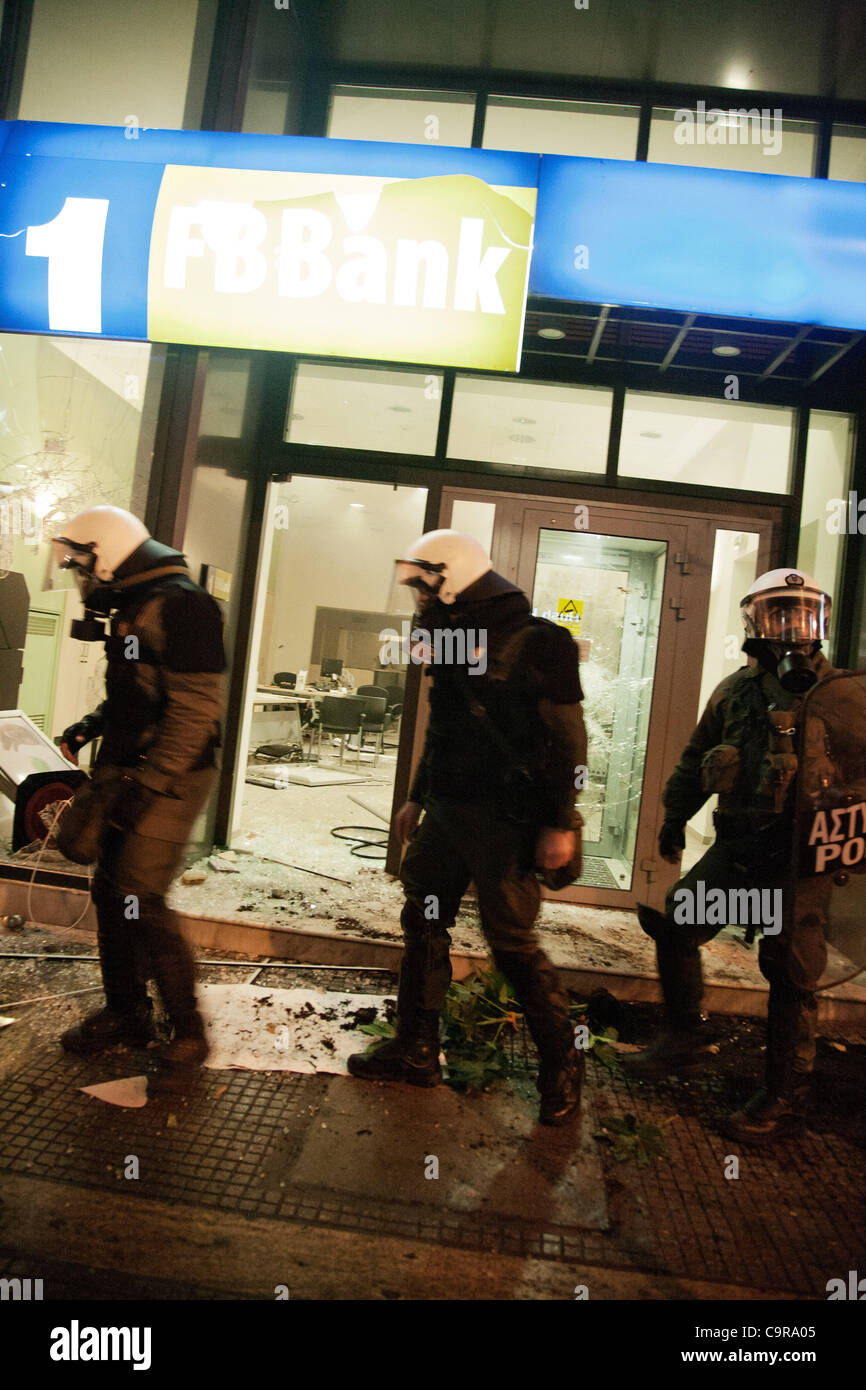 Clashes between police and some demonstrators after a peaceful march of thousands of people in Thessaloniki against - Stock Image