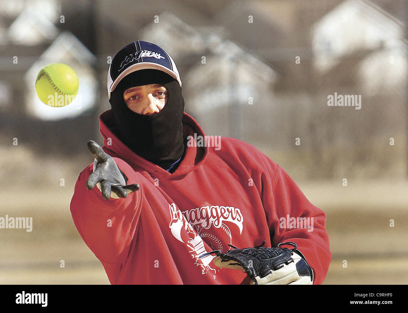Feb. 12, 2012 - Davenport, Iowa, U.S. - Adam Jackson of Rock Island, Ill., pitches the softball Sunday during the - Stock Image
