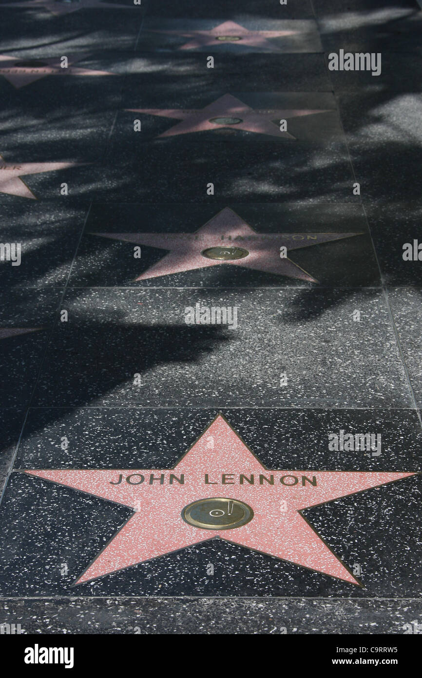 JOHN LENNON & GEORGE HARRISON & RINGO STARR & PAUL MCCARTNEY THE BEATLES WALK OF FAME STARS IN A ROW - Stock Image