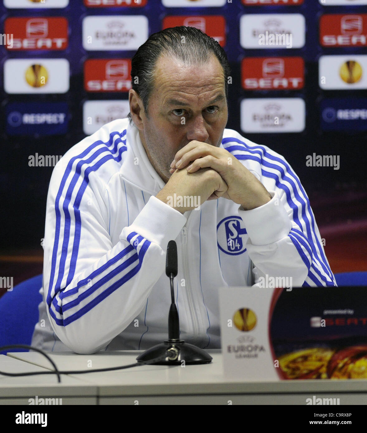 Shalke 04 coach Huub Stevens is seen during a press conference prior to the Europa League match FK Viktoria Plzen - Stock Image