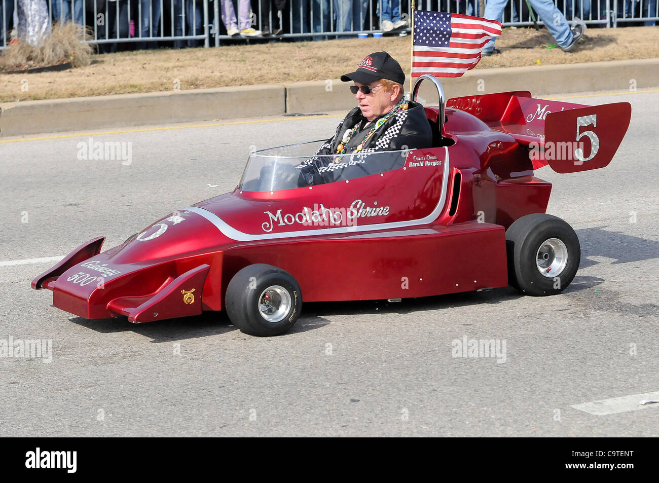 Feb. 18, 2012 - Saint Louis, Missouri, U.S - A member of the Moolah Shriners drives one of the Shriner's famous - Stock Image