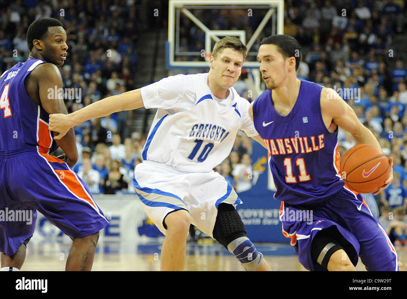 Feb. 21, 2012 - Omaha, Nebraska, U.S - Evansville guard Colt Ryan (11) drives Creighton guard Grant Gibbs (10) into - Stock Image